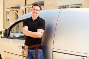 technician-standing-by-service-van