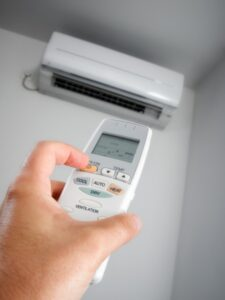 hand-holding-remote-for-ductless-air-handler