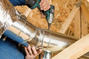 technician-hands-working-on-ductwork